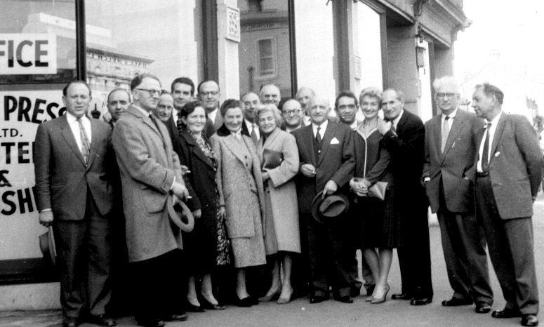 Outside the Jewish News offices at 198 Faraday Street Carlton. The group includes Hirsh Munz, Rachel Holzer, Mendl Balberyszki and Jacob Waislitz, circa early 1960s.