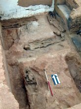 Lower burials situated in pits at the north end of Room 2.